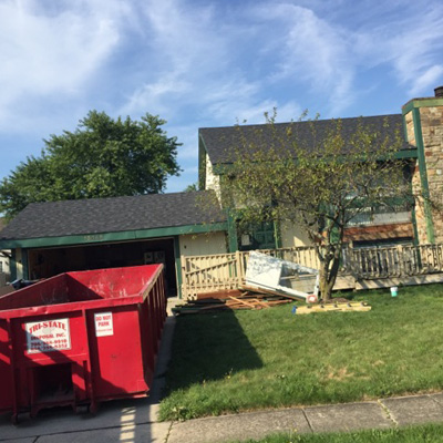 dumpster for roof replacement in driveway
