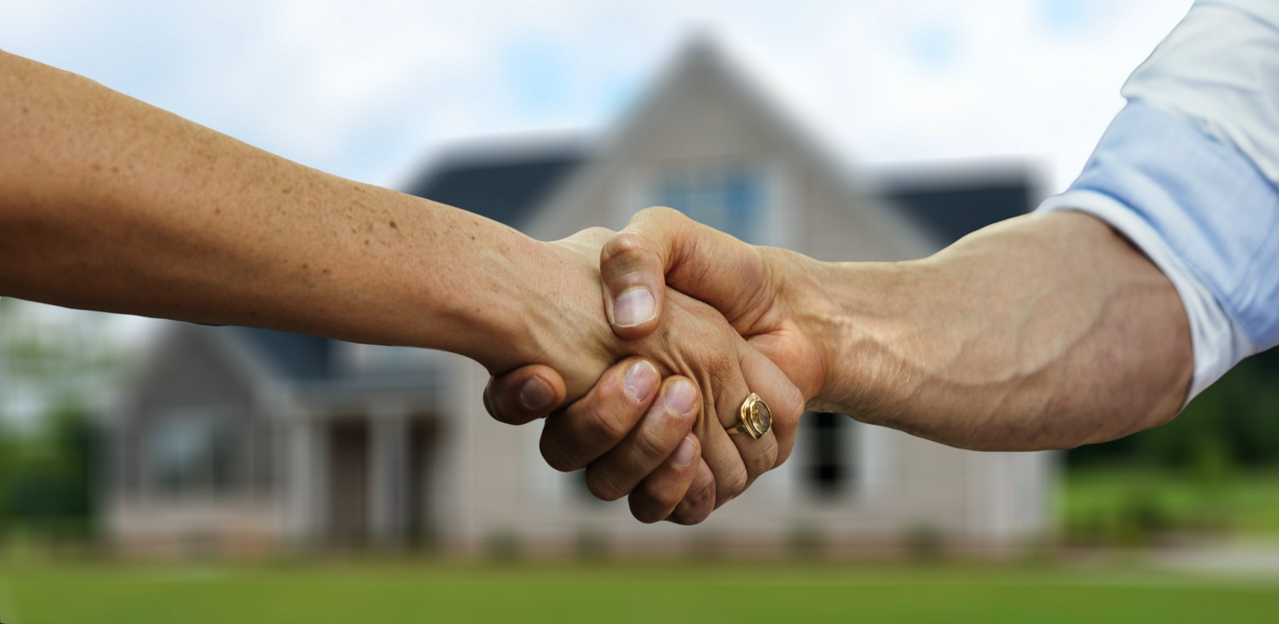 hand shake with a trusted local roof company