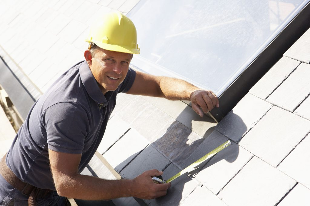 roofing contractor taking measurements